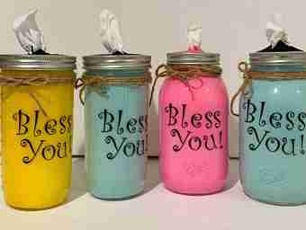 This picture shows what the bless you Mason jars will look like after following the iinstructions on the page.
